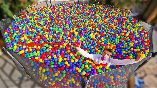 turning a trampoline into a ball pit - fun things to do on a trampoline