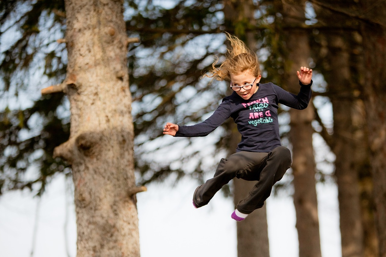 kid happily jumping mid-air