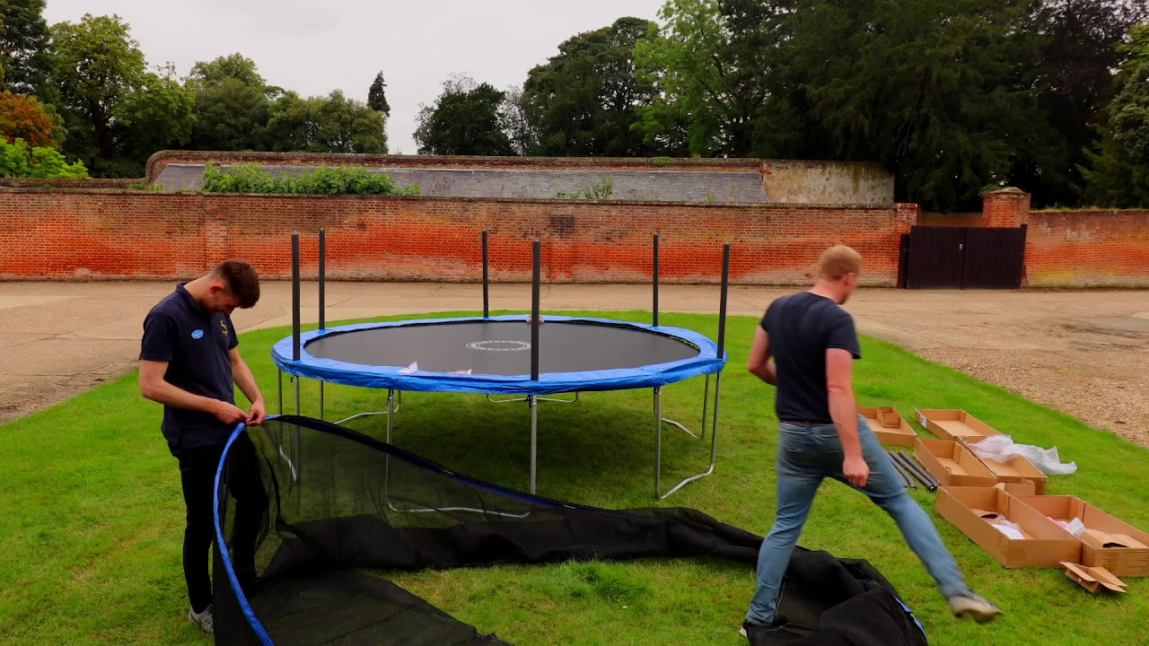 men assembling the sportspower trampoline