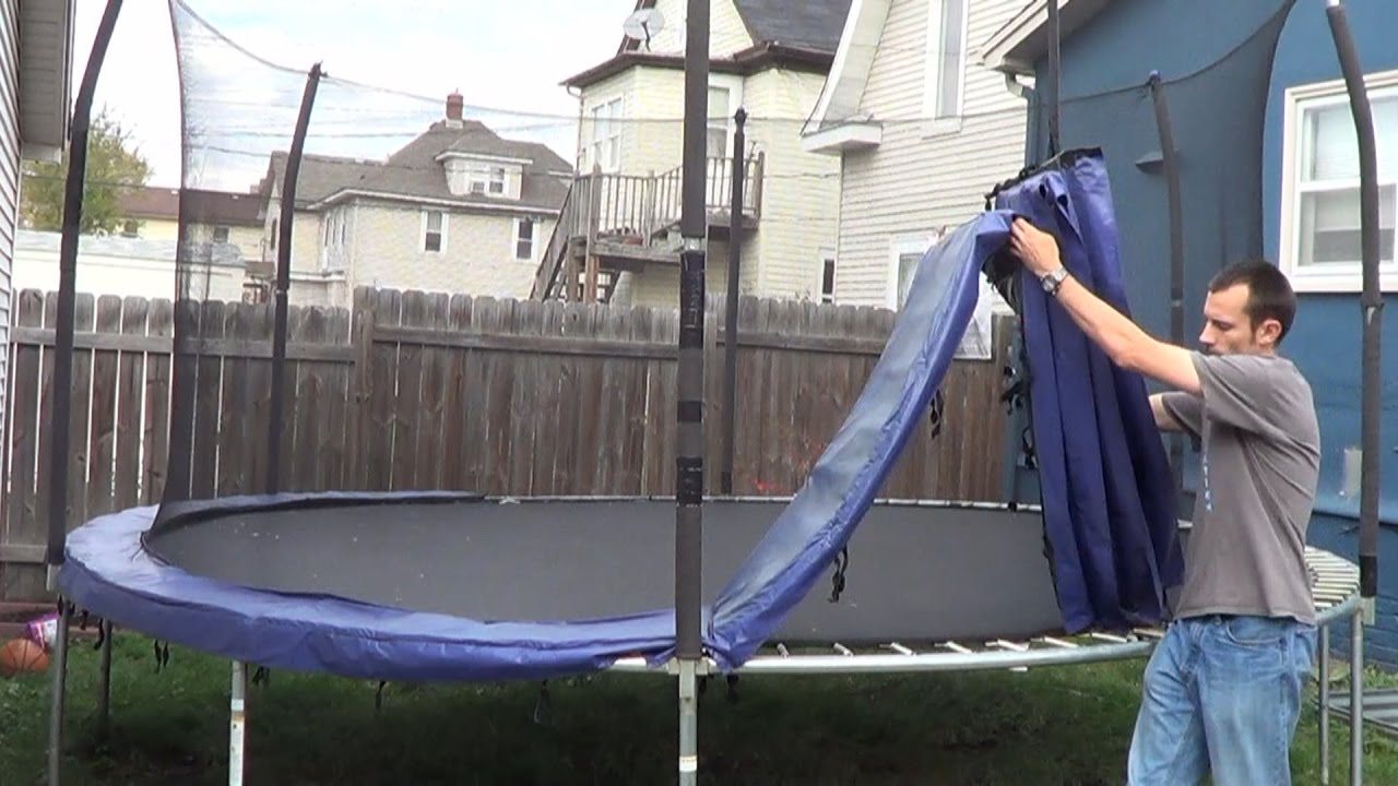 man taking down the trampoline