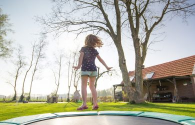 small girl jumping on a trampoline