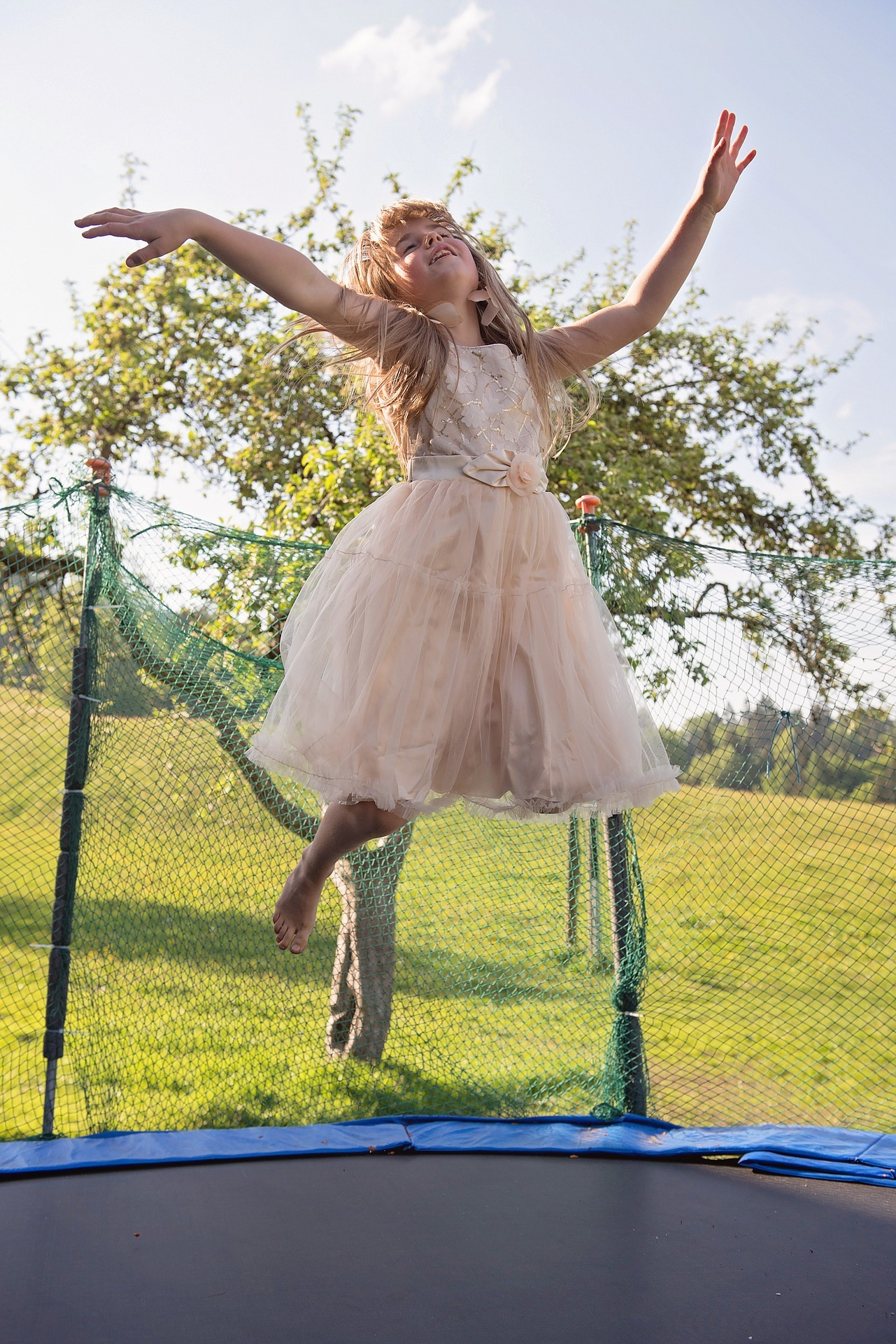 Little girl is flying after jumping the trampoline