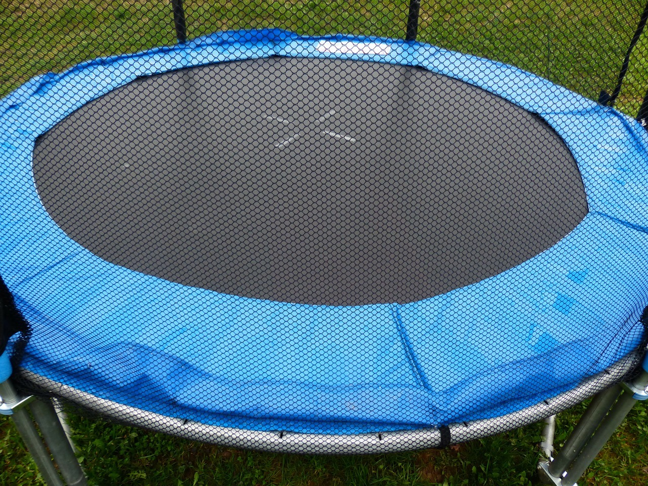 Blue and black trampoline