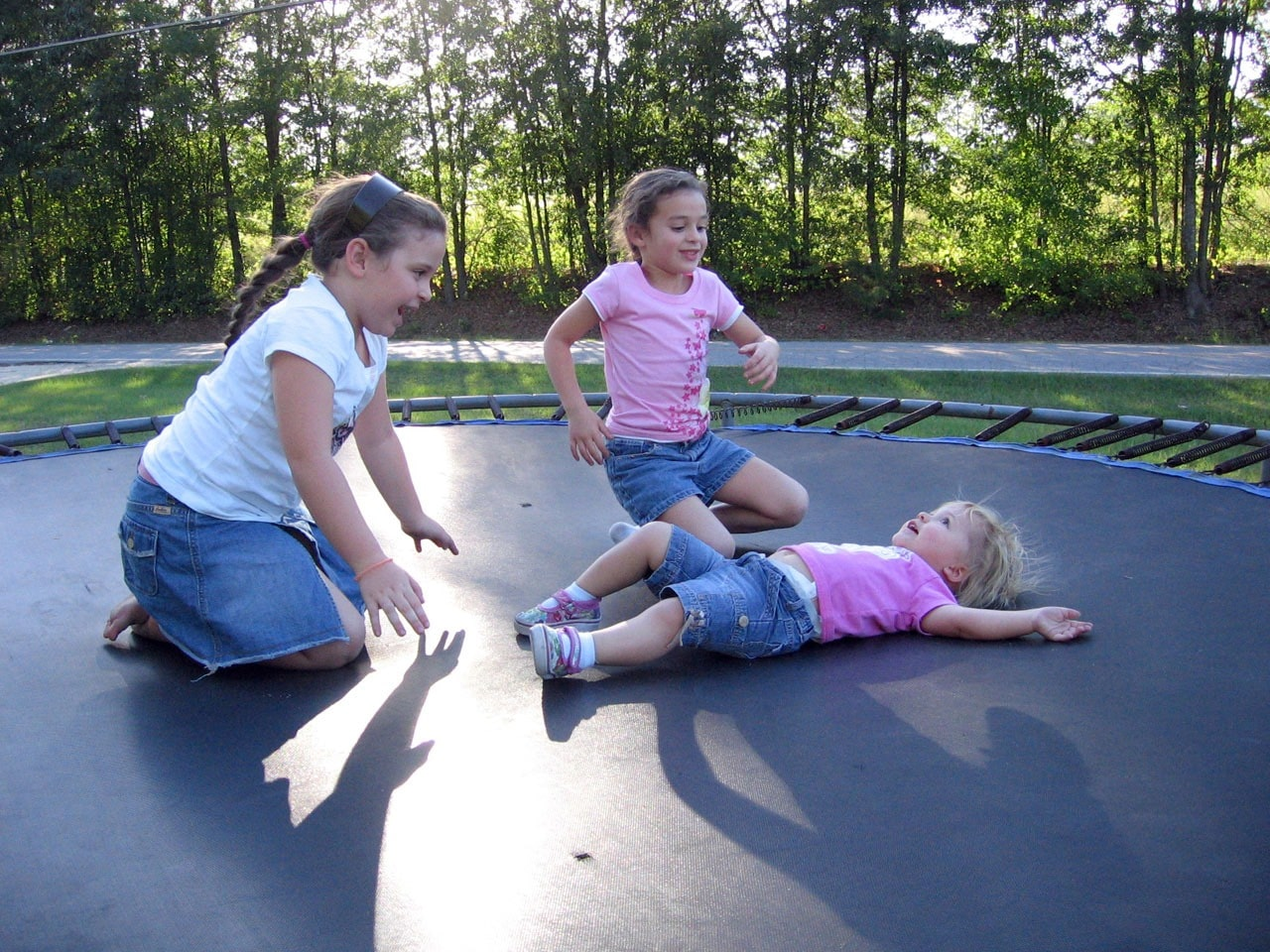 Girls playing on trampoline